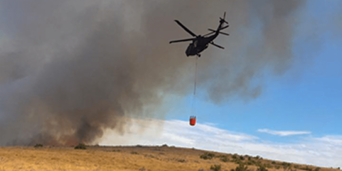 Helicopter bringing water to a fire