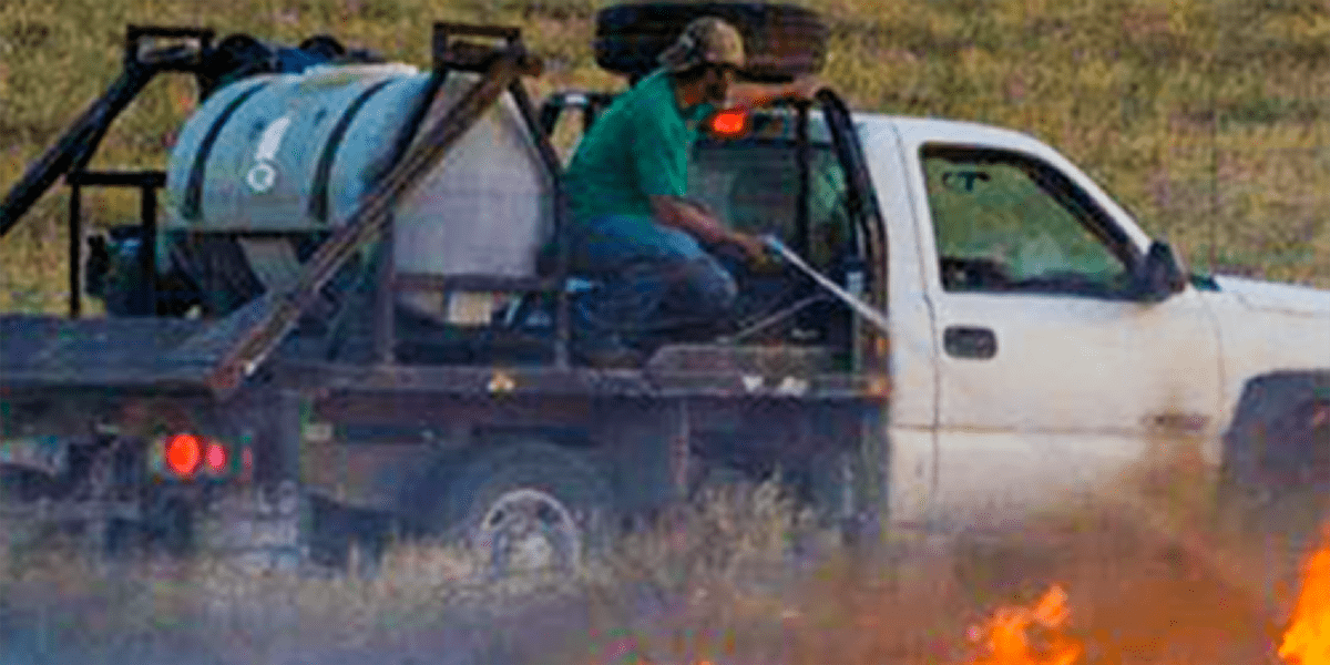 Man putting out fire